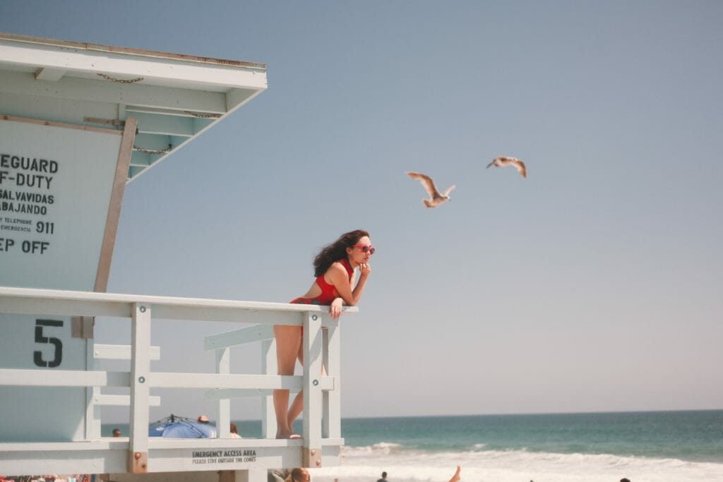 A lifeguard watching over a beach with seagulls in the background